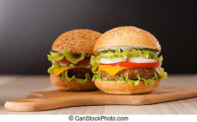 hamburger - juicy hamburger with vegetables on table
