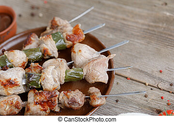 Juicy kebabs of pork cooked on an open fire. Still life on a wooden background.