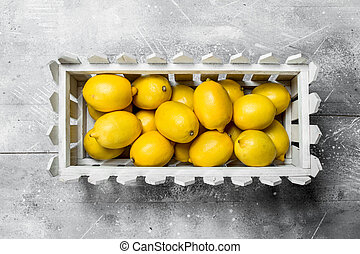 Juicy lemons in the box.
