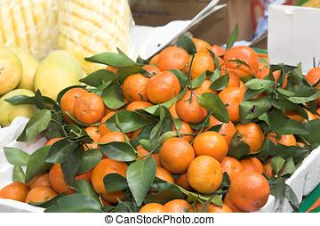 Juicy mandarines for sale - Juicy mandarines at a market for...