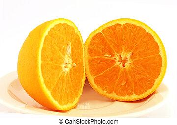 Juicy orange on a plate - Orange cut in half. Juicy and ...