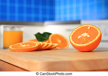 Juicy orange on the kitchen.