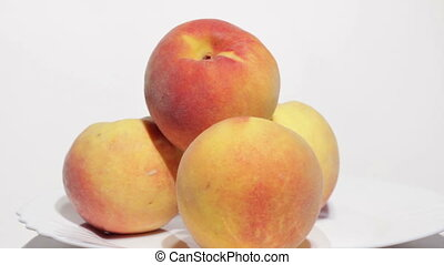 Juicy peaches on white background.