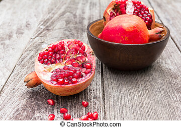 Juicy pomegranates on wood - Juicy pomegranates on old wood