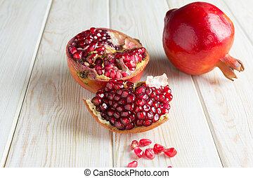 Juicy pomegranates on wood  - Juicy pomegranates on wood