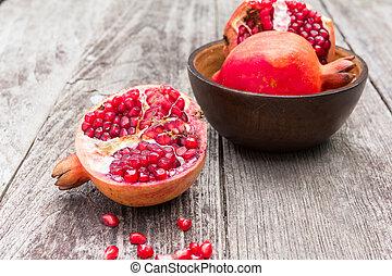 Juicy pomegranates on wood - Juicy pomegranates on old wood...