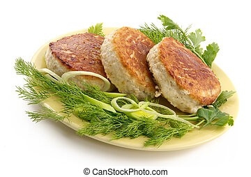 Juicy pork chops with a garnish from greens