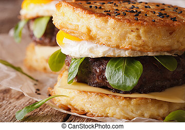 Juicy ramen burger with egg macro on the table. horizontal