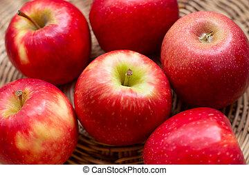 Juicy red apples in a basket