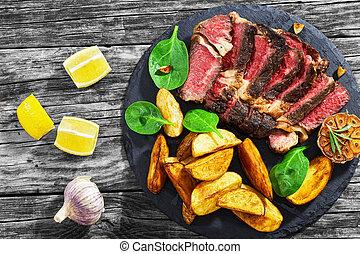 Juicy rib eye beef steak medium rare