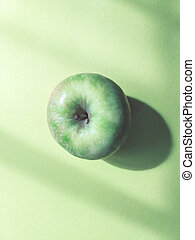 Juicy, ripe apple on a yellow background