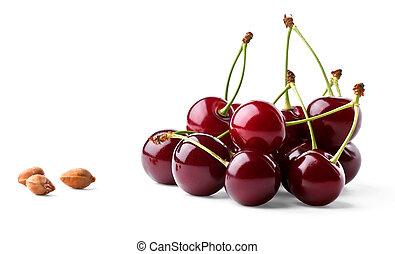 Juicy ripe cherries and cherrystones