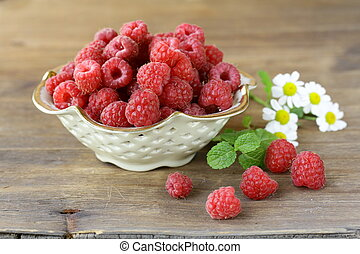 juicy ripe raspberries with mint