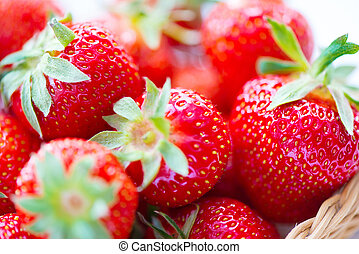 Juicy ripe strawberries in basket