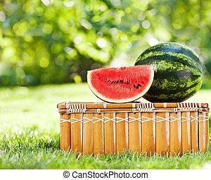 Juicy slice of watermelon on picnic hamper - Juicy slice and...