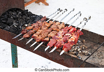 Juicy slices of meat prepared on fire