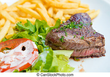steak beef meat with tomato and french fries