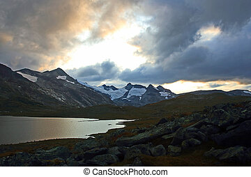 Juicy sunset on the background of Mountain lakes. Jotunheimen National Park. Norway