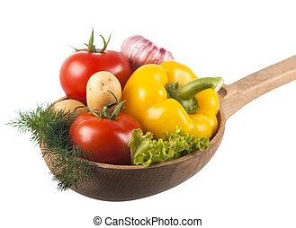 juicy vegetables in a wooden spoon