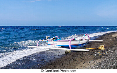 Jukung, the traditional Balinese fishing boat, at the beach in Amed. Bali, Indonesia