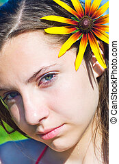 Julia - Young attractive girl with a flower in hair