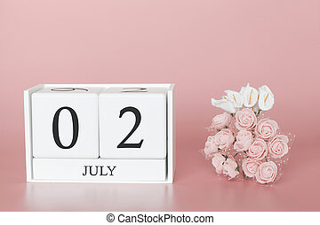 July 02nd. Day 2 of month. Calendar cube on modern pink background, concept of bussines and an importent event.