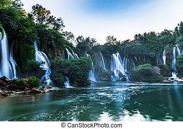 July 12, 2016: Panoramic view of the Kravica Waterfalls,...