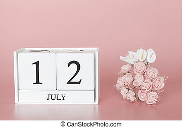 July 12th. Day 12 of month. Calendar cube on modern pink background, concept of bussines and an importent event.