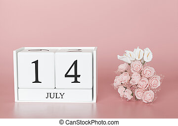 July 14th. Day 14 of month. Calendar cube on modern pink background, concept of bussines and an importent event.