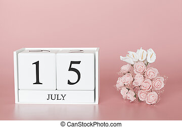 July 15th. Day 15 of month. Calendar cube on modern pink background, concept of bussines and an importent event.
