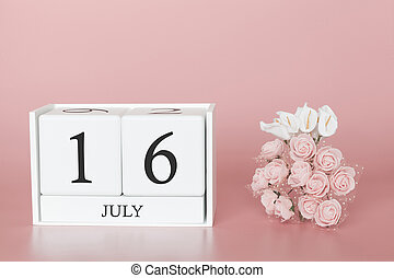 July 16th. Day 16 of month. Calendar cube on modern pink background, concept of bussines and an importent event.
