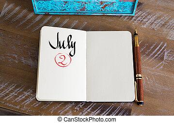 July 2 Calendar Day handwritten on notebook