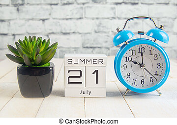 July 21 on the wooden calendar.The twenty-first day of the summer month, a calendar for the workplace. Summer