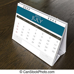 July Calendar  2015 on wood table