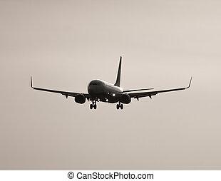 Jumbo jet high contrast landing - Long shot of Jumbo jet...