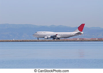 Jumbo jet on the runway at San Francisco International...