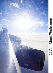 Jumbo Jet wing backlit by amazing sunset