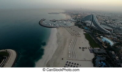 Jumeirah Beach near Burj Al Arab hotel in Dubai, UAE. Helicopter view