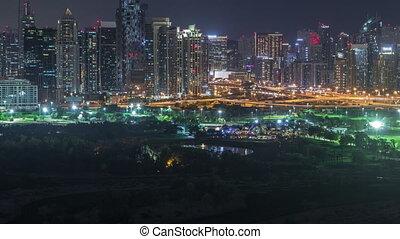 Jumeirah lake towers and Dubai marina skyscrapers and golf...