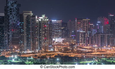 Jumeirah lake towers skyscrapers and golf course night...