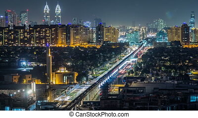 Jumeirah Palm island skyline night timelapse in Dubai, UAE.