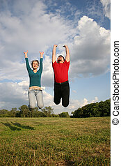 jump couple on meadow