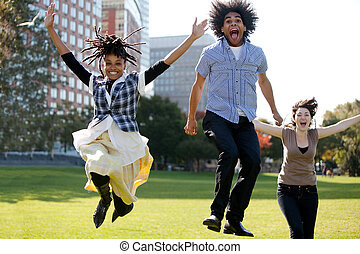 Jump for Joy - A group of people jumping for joy in a city...
