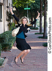 Jump For Joy! - Beautiful, happy, laughing business woman...