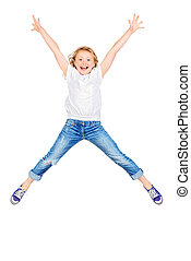 jump for joy - Happy girl in jumping for joy. Studio shot....
