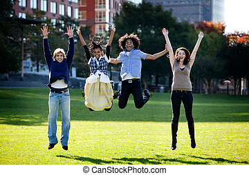 Jump for Joy - A group of happy people running towads the...