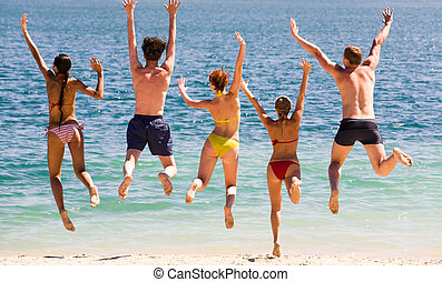 Jump in the lake - Portrait of five teens jumping in the...