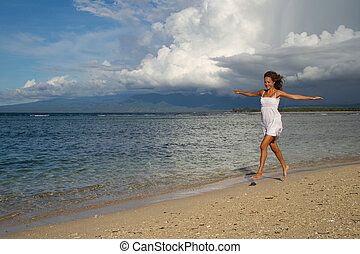 Jump of a beautiful woman at beach