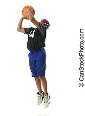 Jump Shot - A preteen athlete making a basketball jump shot....