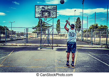 Jump shot in a basketball court